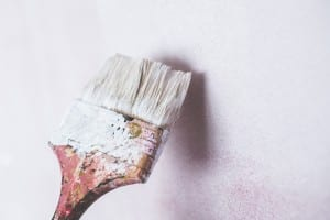 Paint brush against a wall