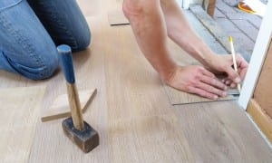 Person laying hardwood at home